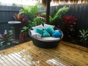 Balinese thatched hut with tropical garden and oversized seat with cushions
